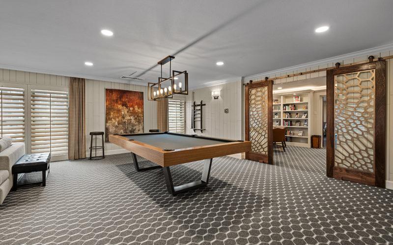 Ambassador East - pool table, flooring, and barn doors